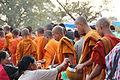 Monks collecting alms - Bun Vat Phu.JPG