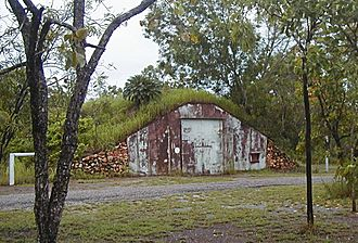 Nissen hut - One of many Nissen huts covered with earth and used for munition storage during the Second World War. Charles Darwin National Park, Darwin, NT, Australia, 2006