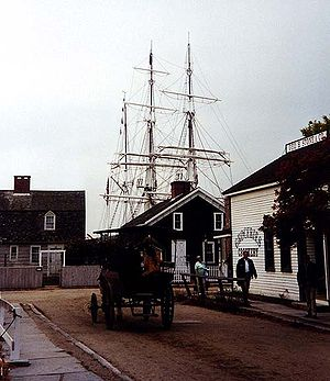 Street in Mystic Seaport, masts of Charles W. ...