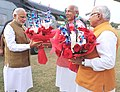 Narendra Modi being received by the Governor of Haryana, Prof. Kaptan Singh Solanki and the Chief Minister of Haryana, Shri Manohar Lal Khattar, on his arrival at Sonipat, in Haryana on November 05, 2015.jpg