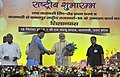 Narendra Modi being welcomed by the Minister of State (Independent Charge) for Power, Coal and New and Renewable Energy, Shri Piyush Goyal, at the function to launch various developmental schemes, at DLW Ground, Varanasi.jpg