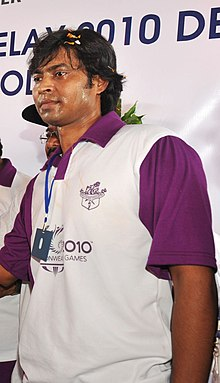 National Hockey player, Shri Dilip Tirkey holding the Queen's Baton 2010 Delhi, at Jamshedpur on August 08, 2010 (cropped).jpg