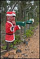 Ned Kelly guarding the mail boxes-1+ (2155822264).jpg