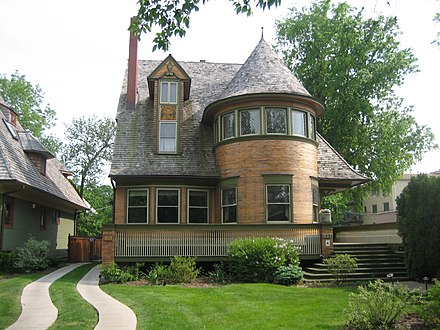 The Walter Gale House, Oak Park, Illinois (1893). While a Queen Anne in style, it features window bands and a cantilevered porch roof which hint at Wright's developing aesthetics