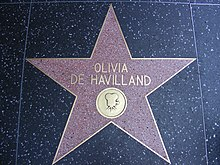Five-pointed star with her name and an image of an old film camera