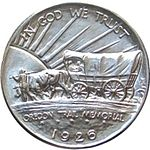 Covered wagon on one side of the coin