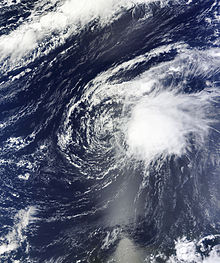 Satellite imagery of a disorganized tropical cyclone in the central Atlantic on October 4