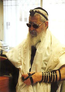 side view of rabbi ovadia yosef wearing tefillin