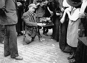 Bleuet de France - A war amputee selling bleuets on the Champs-Élysées, 4 July 1919.