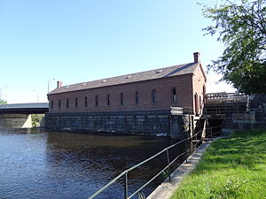 Lowell Power Canal System and Pawtucket Gatehouse - Pawtucket Gatehouse, from the above the falls side. Barge lock chamber to the right of the gatehouse.
