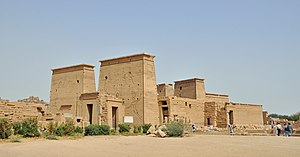 Egyptian temple - The Temple of Isis at Philae, with pylons and an enclosed court on the left and the inner building at right