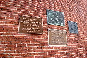 Phoenix Shot Tower - Plaques at the Phoenix Shot Tower, formerly the Merchants Shot Tower, in Baltimore's Jonestown neighborhood
