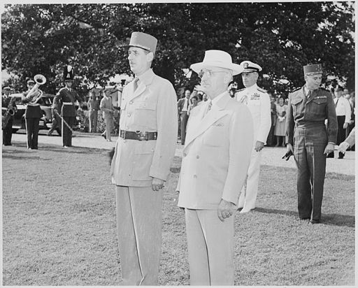 Photograph of President Truman and French President Charles de Gaulle, standing at attention during welcoming... - NARA - 199187