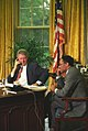 Photograph of President William J. Clinton and Secretary of Agriculture Mike Espy on Telephones in the Oval Office.jpg