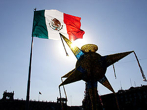 Monumental flag and piñata at the Zócalo of Me...