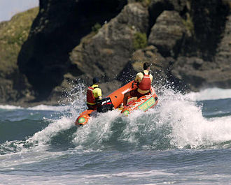 Piha Rescue - Piha IRB with Fallen Rocks in Background
