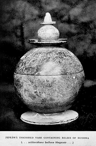 "Piprahwa vase with relics of the Buddha. The inscription reads: ...salilanidhane Budhasa Bhagavate... (Brahmi script: ...  ...]) ""Relics of the Buddha Lord"". Piprawa vase with relics of the Buddha.jpg"