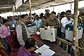 Polling officials carrying the Electronic Voting Machines (EVMs) and other necessary inputs required for the Tripura Assembly Election, at the distribution centre, in Agartala on February 17, 2018.jpg