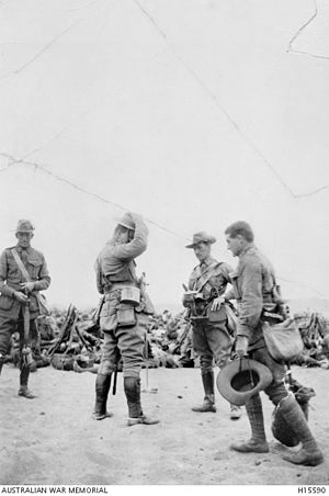Harold Edward Elliott - Elliott (second from left) and McNicoll (third from left) taking a rest during training in the desert.