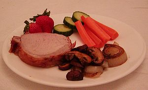 pork loin roast dinner with mushrooms, onions,...