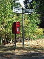 Postbox And Road Sign - geograph.org.uk - 1513499.jpg
