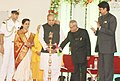 Pranab Mukherjee lighting the lamp to inaugurate the New Vedic Cultural Centre of International Society for Krishna Consciousness ISKCON, at Pune. The Governor of Maharashtra, Shri K. Sankaranarayanan is also seen.jpg