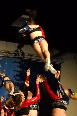 Cheerleading - All-Star cheerleaders performing a prep double
