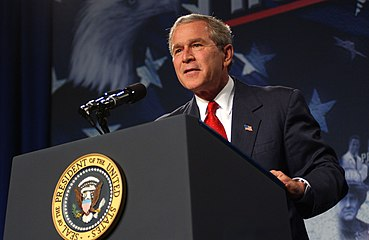 George W. Bush is seen giving a speech.