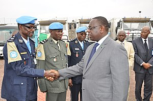 Etiquette in Africa - President of Senegal Macky Sall shaking hands with local government officials