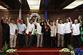 President Rodrigo Duterte and newly-elected officers of the Presidential Photojournalists Association raise their fist during an oath-taking ceremony in Malacañan on September 26.jpg