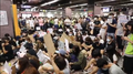 Protester sitting in Prince Edward Station Concourse 20190906.png