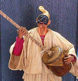 Music of Naples -  The Neapolitan folk-figure, Pulcinella, playing the putipù.