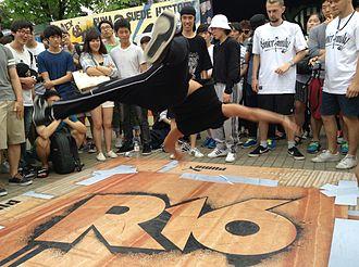 Power move - A b-boy doing an air flare at R16 in Seoul, South Korea.
