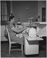 """REA, """"Woman at work in kitchen"""", photo by Campbell - NARA - 195873.tif"""