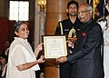 Ram Nath Kovind presenting the Nari Shakti Puruskar for the year 2017 to Ms. Deepika Kundaji, Auroville, Tamil Nadu, at a function, on the occasion of the International Women's Day, at Rashtrapati Bhavan, in New Delhi.jpg