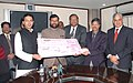 Ram Vilas Paswan being presented the interim dividend cheque from the CMD, National Minerals Development Corporation (NMDC), Shri Rana Som, in New Delhi on February 26, 2009.jpg