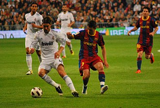 David Villa - Villa challenging Sergio Ramos for the ball after scoring two goals in Barcelona's 5-0 victory over Real Madrid.