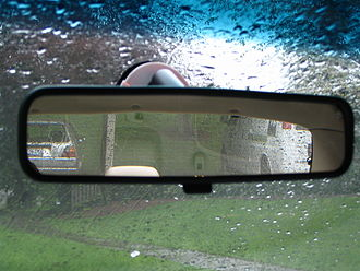 Rear-view mirror - Rear-view mirror showing cars parked behind the vehicle containing the mirror