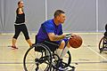 Retired U.S. Air Force Staff Sgt. Larry Franklin dribbles the ball down the court during a wheelchair basketball game against the Navy-Coast Guard team during the Wounded Warrior Pacific Invitational at Joint 140109-N-HA927-009.jpg