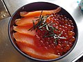 Rice bowl topped with salmon and salmon egg (14904439935).jpg