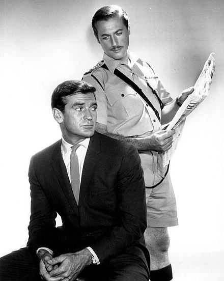 Taylor (seated) with Lloyd Bochner in the TV series Hong Kong, 1961
