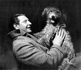 Roger Livesey - Roger Livesey and his canine co-star in the Theatre Guild production Storm Over Patsy (1937)