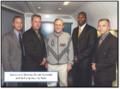 Rumsfeld and Security Team.png