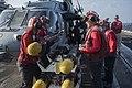 Sailors load AG Hellfire missiles onto an MH-60S Sea Hawk helicopter. (39893244305).jpg