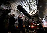 Sailors load a Mark 54 Lightweight Torpedo onto a P-3C Orion patrol aircraft. (32251074210).jpg