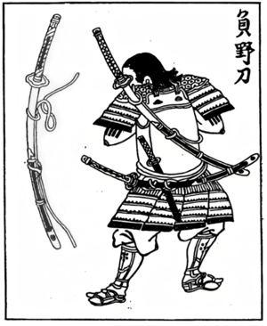 Scabbard - A Japanese Edo period wood block print of a samurai carrying a nodachi/ōdachi on his back