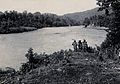 Sarawak; three tribesmen standing by the Baram River. Photog Wellcome V0037448.jpg