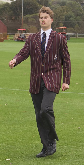 Scotch College, Perth - Year 12 school uniform for winter term. In addition to this, the student is wearing a colours tie, which has been duly awarded by the Headmaster and Captain of School for his achievements towards either the Academic field or in the majority of cases for sporting colours. This tie can also be awarded in some cases for community service colours.
