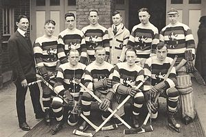 "Seattle Metropolitans - Seattle Metropolitans around 1919–1921. Back row: Pete Muldoon, Bobby Rowe, Charles Tobin, Hugh ""Muzz"" Murray, unknown, Roy Rickey, Harry ""Hap"" Holmes. Front row: Jack Walker, Frank Foyston, Bernie Morris, Jim Riley."
