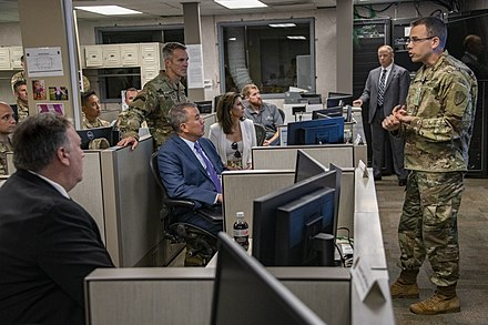 An Army officer briefs Secretary of State Mike Pompeo (left, foreground) on counter-ISIL social media activities at MacDill AFB, June 2018.
